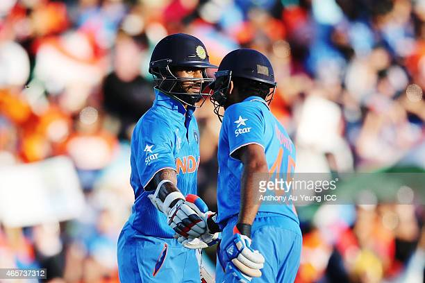 Shikhar Dhawan and Rohit Sharma of India in their partnership during the 2015 ICC Cricket World Cup match between Ireland and India at Seddon Park on...