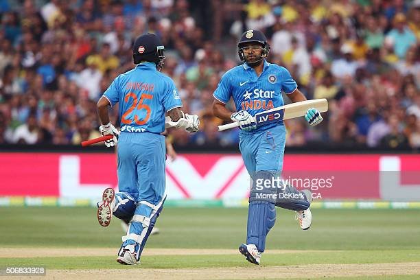 Shikhar Dhawan and Rohit Sharma of India run between the wickets during game one of the Twenty20 International match between Australia and India at...