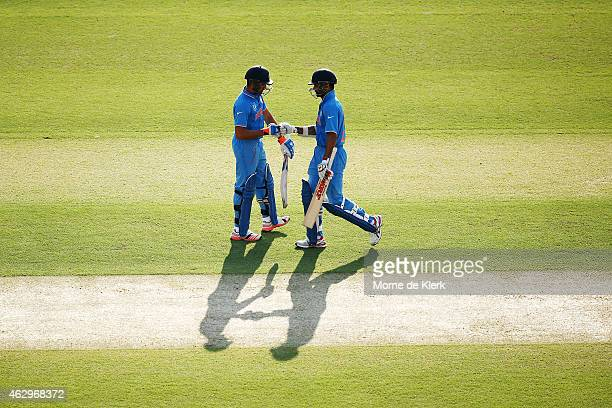 Shikhar Dhawan and Rohit Sharma of India speak between overs during the ICC Cricket World Cup warm up match between Australia and India at Adelaide...