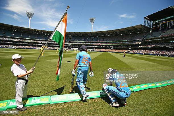 Shikhar Dhawan and Rohit Sharma of india walk out to bat during game three of the One Day International Series between Australia and India at the...
