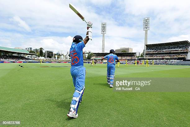Shikhar Dhawan and Rohit Sharma of India walk out to bat during the Victoria Bitter One Day International Series match between Australia and India at...