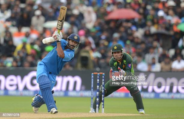 Shikhar Dhawan batting for India watched by Pakistan wicketkeeper Kamran Akmal during the ICC Champions Trophy group match between India and Pakistan...