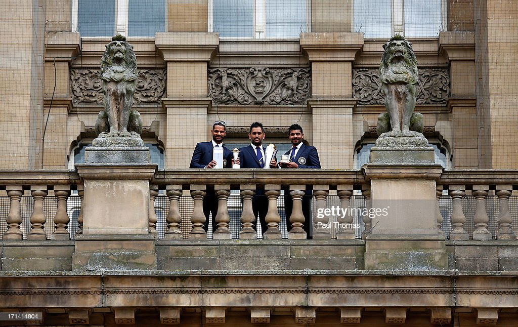 <a gi-track='captionPersonalityLinkClicked' href=/galleries/search?phrase=Shikhar+Dhawan&family=editorial&specificpeople=650580 ng-click='$event.stopPropagation()'>Shikhar Dhawan</a>, MS Dhoni and <a gi-track='captionPersonalityLinkClicked' href=/galleries/search?phrase=Ravindra+Jadeja&family=editorial&specificpeople=4880243 ng-click='$event.stopPropagation()'>Ravindra Jadeja</a> of India during ICC Champions Trophy Winners Photocall at the Birmingham City Council Building on June 24, 2013 in Birmingham, England.
