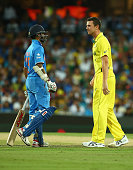 Shikhar Dhawan of India and Josh Hazlewood of Australia stare at each other after a midpitch collision during the 2015 Cricket World Cup Semi Final...