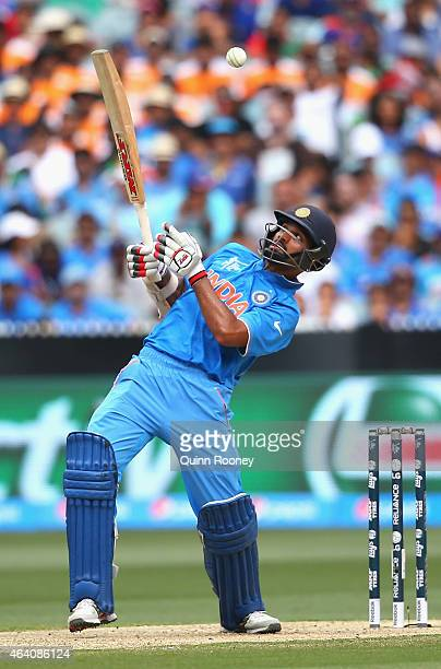 Shikhar Dhawan of India attempts to avoid a high pitched delivery during the 2015 ICC Cricket World Cup match between South Africa and India at...