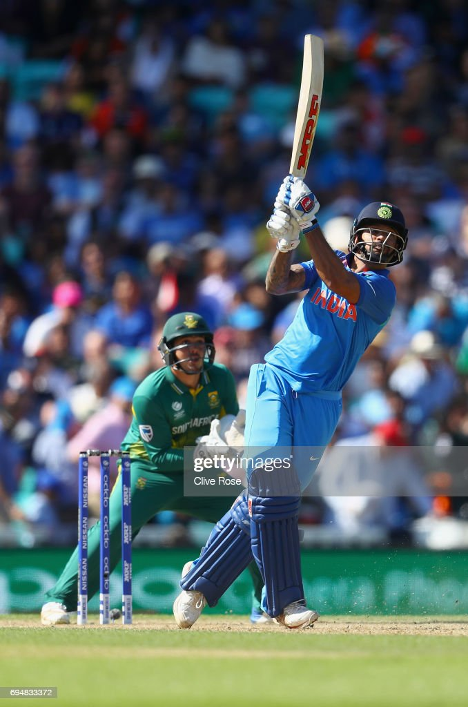 Shikhar Dhawan of India attempts to hit a six but is caught during the ICC Champions trophy cricket match between India and South Africa at The Oval in London on June 11, 2017