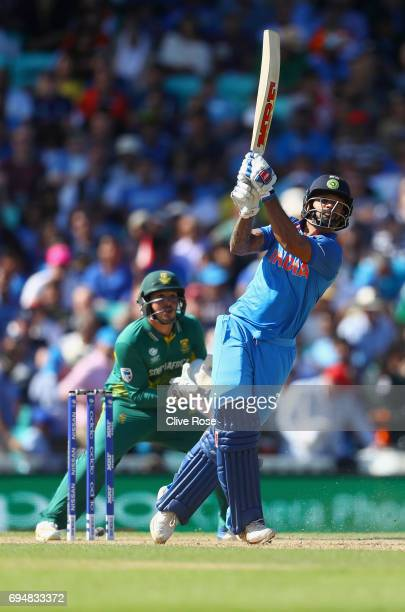 Shikhar Dhawan of India attempts to hit a six but is caught during the ICC Champions trophy cricket match between India and South Africa at The Oval...