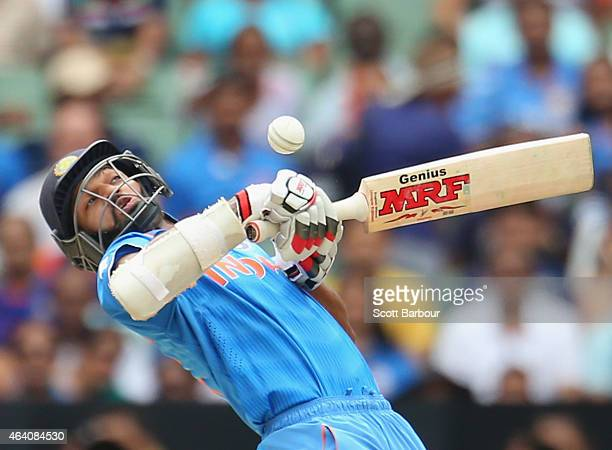 Shikhar Dhawan of India avoids a short ball from Dale Steyn of South Africa during the 2015 ICC Cricket World Cup match between South Africa and...