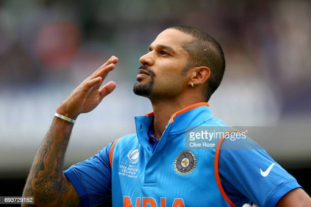 Shikhar Dhawan of India blows a kiss to the crowd as he leaves the field after being dismissed during the ICC Champions trophy cricket match between...