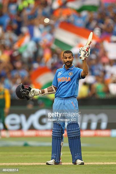 Shikhar Dhawan of India celebrates after scoring his century during the 2015 ICC Cricket World Cup match between South Africa and India at Melbourne...