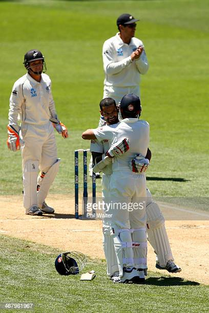 Shikhar Dhawan of India celebrates his century during day four of the First Test match between New Zealand and India at Eden Park on February 9 2014...