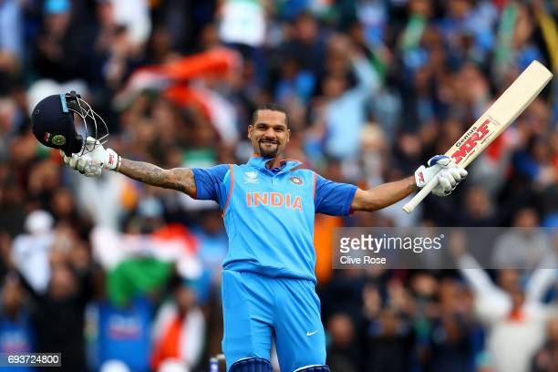 Shikhar Dhawan of India celebrates his century during the ICC Champions trophy cricket match between India and Sri Lanka at The Oval in London on...