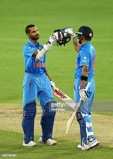 Shikhar Dhawan of India celebrates his century with team mate Virat Kohli during the Victoria Bitter One Day International match between Australia...