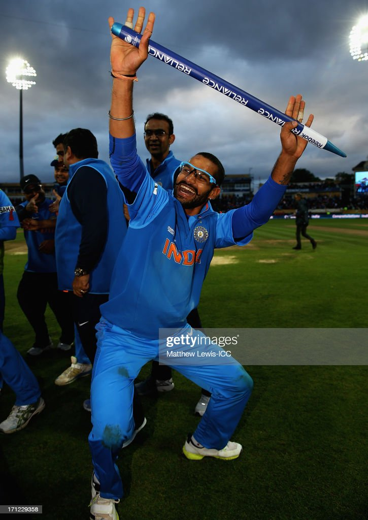 <a gi-track='captionPersonalityLinkClicked' href=/galleries/search?phrase=Shikhar+Dhawan&family=editorial&specificpeople=650580 ng-click='$event.stopPropagation()'>Shikhar Dhawan</a> of India celebrates his teams win over England during the ICC Champions Trophy Final between England and India at Edgbaston on June 23, 2013 in Birmingham, England.