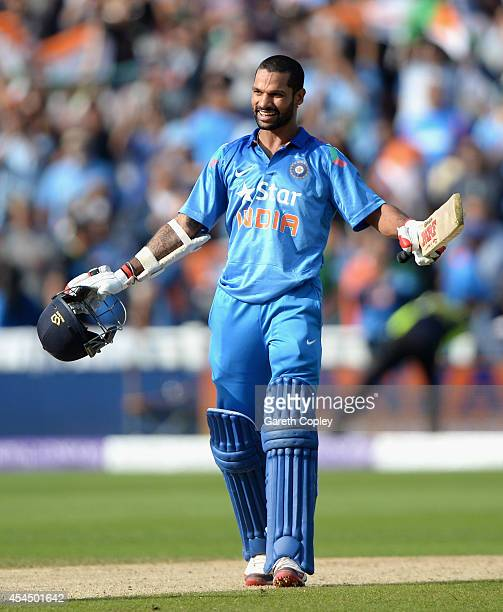 Shikhar Dhawan of India celebrates hitting the winning runs during the 4th Royal London One Day International match between England and India at...