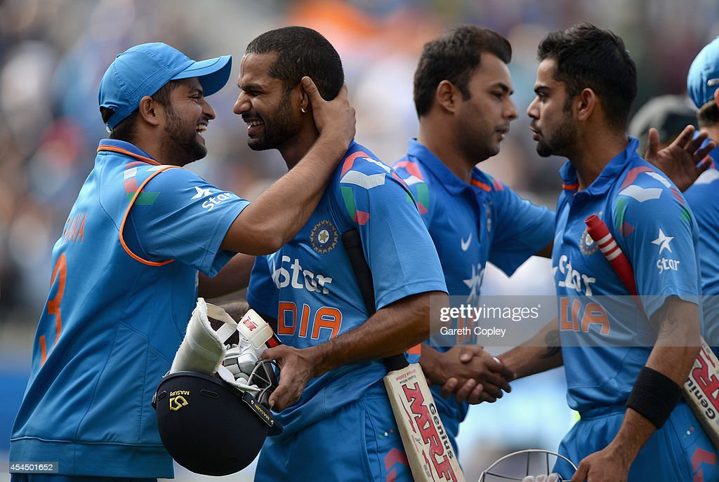 Shikhar Dhawan of India celebrates with Suresh Raina of India after hitting the winning runs during the 4th Royal London One Day International match...