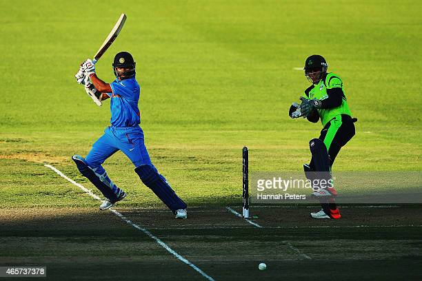 Shikhar Dhawan of India cuts the ball away for four runs during the 2015 ICC Cricket World Cup match between Ireland and India at Seddon Park on...