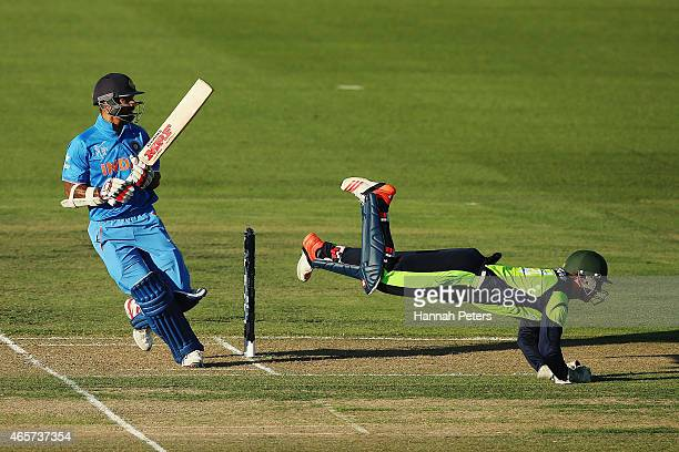 Shikhar Dhawan of India cuts the ball past Gary Wilson of Ireland during the 2015 ICC Cricket World Cup match between Ireland and India at Seddon...
