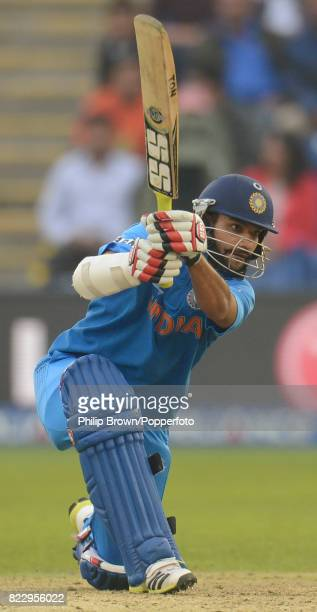 Shikhar Dhawan of India drives during his innings of 68 runs in the ICC Champions Trophy Semi Final between India and Sri Lanka at the Swalec Stadium...