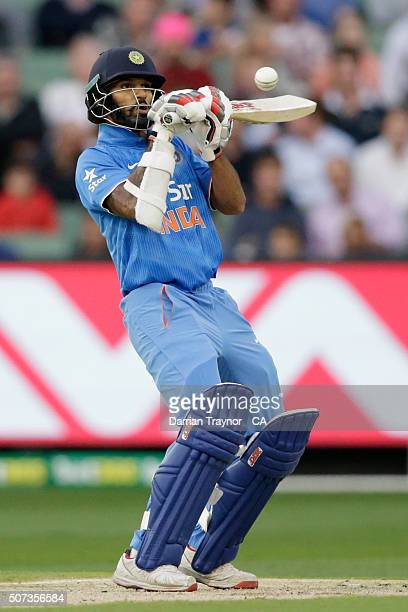 Shikhar Dhawan of India guides a short ball from James Faulkner of Australia for 6 runs during the International Twenty20 match between Australia and...