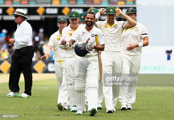 Shikhar Dhawan of India has words with the Australian team at the lunch break during day four of the 2nd Test match between Australia and India at...