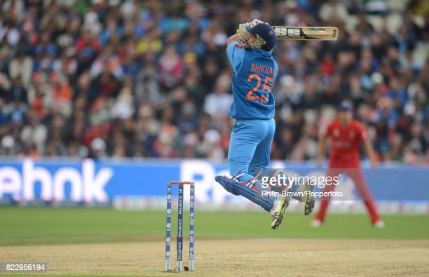 Shikhar Dhawan of India hits a six during his innings of 31 runs in the reducedovers ICC Champions Trophy Final between England and India at...