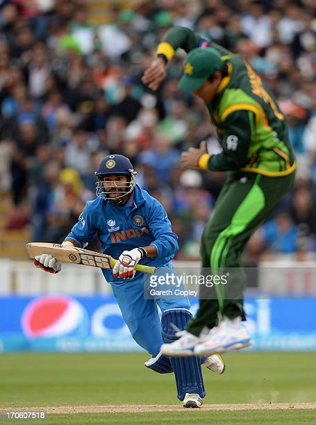 Shikhar Dhawan of India hits the ball past Nasir Jamshed of Pakistan during the ICC Champions Trophy match between India and Pakiatan at Edgbaston on...