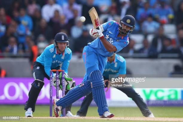 Shikhar Dhawan of India hits to the legside as wicketkeeper Jos Buttler of England looks on during the fourth Royal London OneDay Series match...