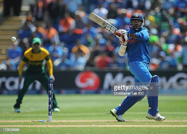 Shikhar Dhawan of India in action as he heads for his century during the ICC Champions Trophy group B match between India and South Africa at Cardiff...