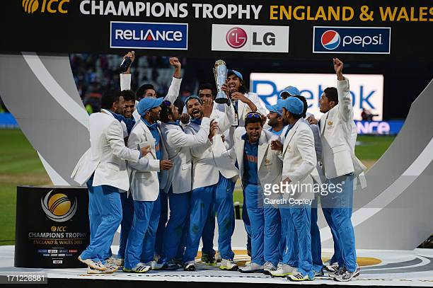 Shikhar Dhawan of India lifts the trophy as he celebrates victory with team mates during the ICC Champions Trophy Final between England and India at...