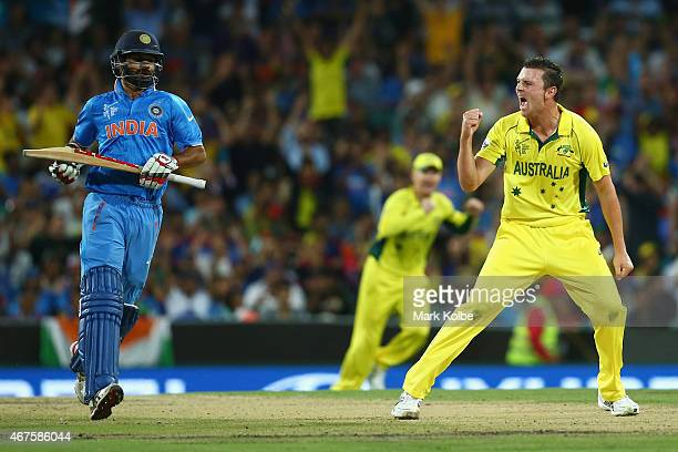 Shikhar Dhawan of India looks dejected as Josh Hazlewood of Australia celebrates taking his wicket during the 2015 Cricket World Cup Semi Final match...