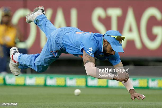Shikhar Dhawan of India misfields during game three of the One Day International Series between Australia and India at Melbourne Cricket Ground on...