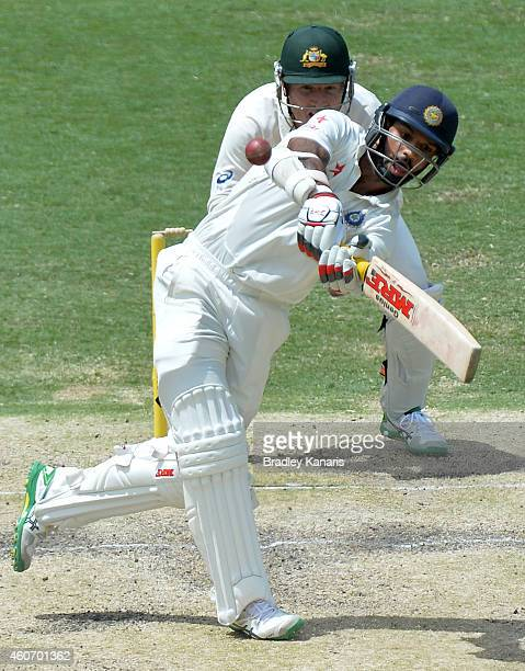 Shikhar Dhawan of India plays a shot during day four of the 2nd Test match between Australia and India at The Gabba on December 20 2014 in Brisbane...