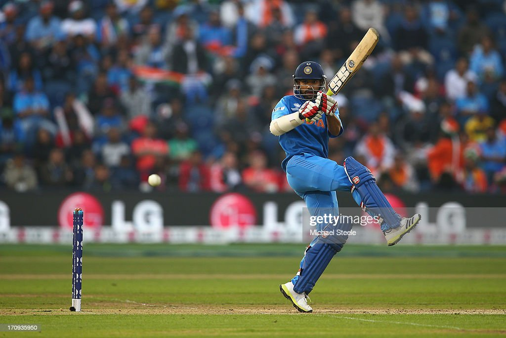 <a gi-track='captionPersonalityLinkClicked' href=/galleries/search?phrase=Shikhar+Dhawan&family=editorial&specificpeople=650580 ng-click='$event.stopPropagation()'>Shikhar Dhawan</a> of India pulls a shot behind square during the ICC Champions Trophy Semi-Final match between India and Sri Lanka at the SWALEC Stadium on June 20, 2013 in Cardiff, Wales.