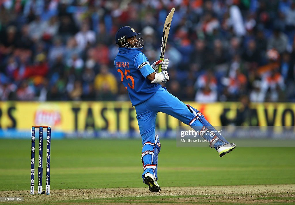<a gi-track='captionPersonalityLinkClicked' href=/galleries/search?phrase=Shikhar+Dhawan&family=editorial&specificpeople=650580 ng-click='$event.stopPropagation()'>Shikhar Dhawan</a> of India pulls the ball towards the boundary during the ICC Champions Trophy Semi Final match between India and Sri Lanka at SWALEC Stadium on June 20, 2013 in Cardiff, Wales.