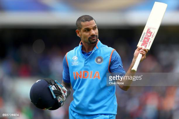 Shikhar Dhawan of India reacts to the crowd as he leaves the field after being dismissed during the ICC Champions trophy cricket match between India...
