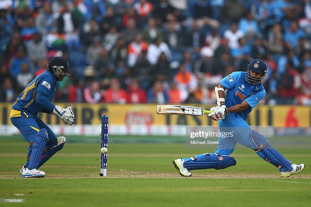 <a gi-track='captionPersonalityLinkClicked' href=/galleries/search?phrase=Shikhar+Dhawan&family=editorial&specificpeople=650580 ng-click='$event.stopPropagation()'>Shikhar Dhawan</a> (R) of India sweeps a delivery as wicketkeeper <a gi-track='captionPersonalityLinkClicked' href=/galleries/search?phrase=Kumar+Sangakkara&family=editorial&specificpeople=206804 ng-click='$event.stopPropagation()'>Kumar Sangakkara</a> (L) of Sri Lanka looks on during the ICC Champions Trophy Semi-Final match between India and Sri Lanka at the SWALEC Stadium on June 20, 2013 in Cardiff, Wales.