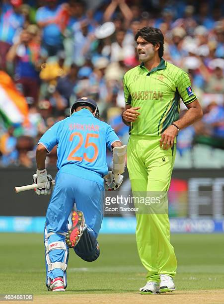Shikhar Dhawan of India takes a single as bowler Mohammad Irfan of Pakistan looks on during the 2015 ICC Cricket World Cup match between India and...