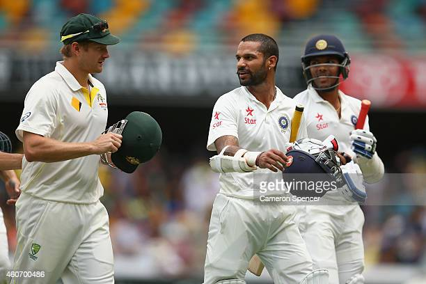 Shikhar Dhawan of India talks to Shane Watson of Australia as he leaves the field for lunch during day four of the 2nd Test match between Australia...