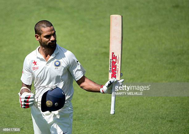 Shikhar Dhawan of India walks from the field after being caught out for 98 runs during day 2 of the 2nd International Test cricket match between New...