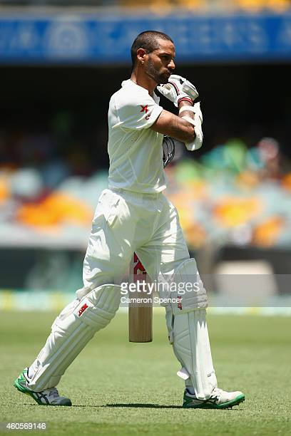 Shikhar Dhawan of India walks off the field after being dismissed by Mitchell Marsh of Australia during day one of the 2nd Test match between...