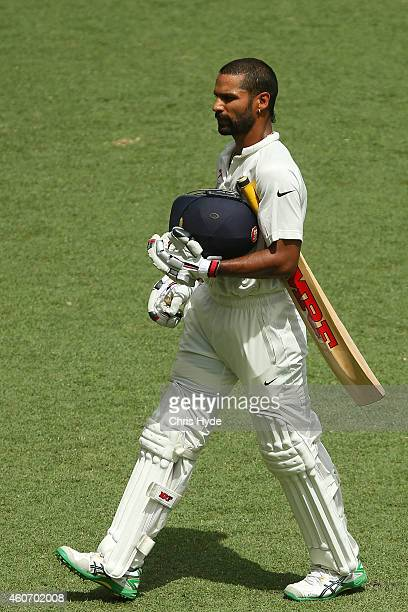 Shikhar Dhawan of India walks off the field after being dismissed by Nathan Lyon of Australia during day four of the 2nd Test match between Australia...
