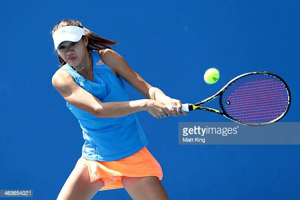 Shilin Xu of China plays a backhand in her first round junior girls' match against Seone Mendez of Australia during the 2014 Australian Open Junior...