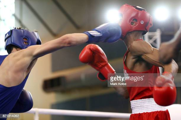 Shiloh Defreitas of England and Josh Fitzpatrick of Australia compete in the Boy's 56 kg Gold Medal bout between Shiloh Defreitas of England and Josh...