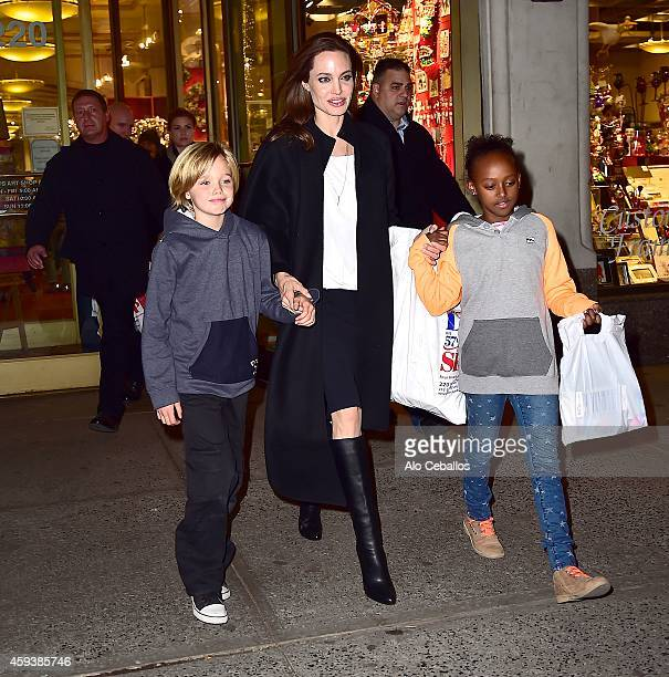 Shiloh JoliePitt Angelina Jolie and Zahara JoliePitt are seen shopping at Lee's art shop in Midtown on November 21 2014 in New York City
