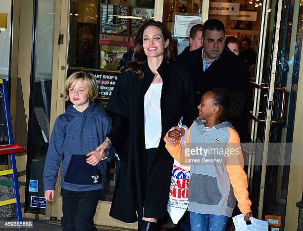 Shiloh JoliePitt Angelina Jolie and Zahara JoliePitt leave Lee's Art Shop on November 21 2014 in New York City