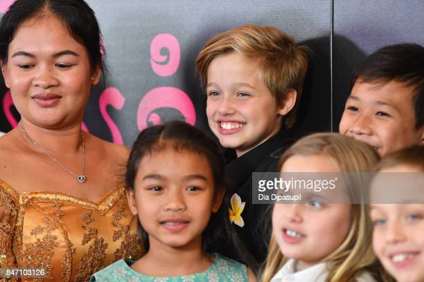 Shiloh JoliePitt Kimhak Mun and Sreymoch Sareum attend the 'First They Killed My Father' New York Premiere on September 14 2017 in New York City