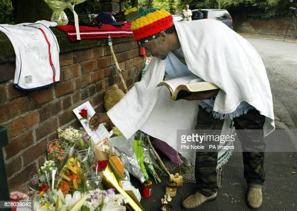 Shiloh Naphtali uncle of murdered teenager Anthony Walker lays a flower near to the spot where his nephew was murdered in the Huyton area of...
