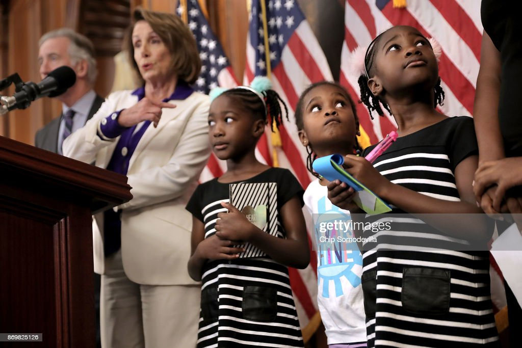 Shiloh Tappin (R) and her twin sister Seilah Tappin (3rd R) and their friend Dani Hebron, all 7 years old, take notes during a news conference conducted by House Minority Leader Nancy Pelosi (D-CA) in the Rayburn Room at the U.S. Capitol November 3, 2017 in Washington, DC. The twins' mother, Kendra Tappin, credited the Supplemental Nutrition Assistance (SNAP) and Children's Health Insurance (CHIP) programs and the Affordable Care Act for making it possible for her to raise her daughters healthy and happy and that the proposed Republican tax cuts would threaten those benefits.