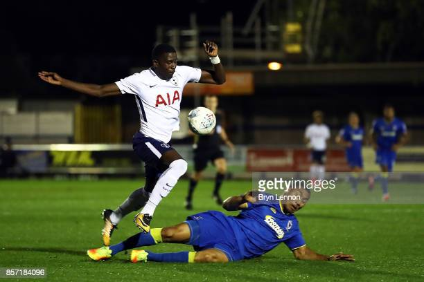 Shilow Tracey of Tottenham Hotspur avoids Darius Charles of AFC Wimbledon during the Checkatrade Trophy match between AFC Wimbledon and Tottenham...